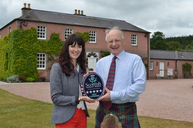 Malcolm Nicol receiving the accreditation from Jo Robinson, Regional Director of Visit Scotland