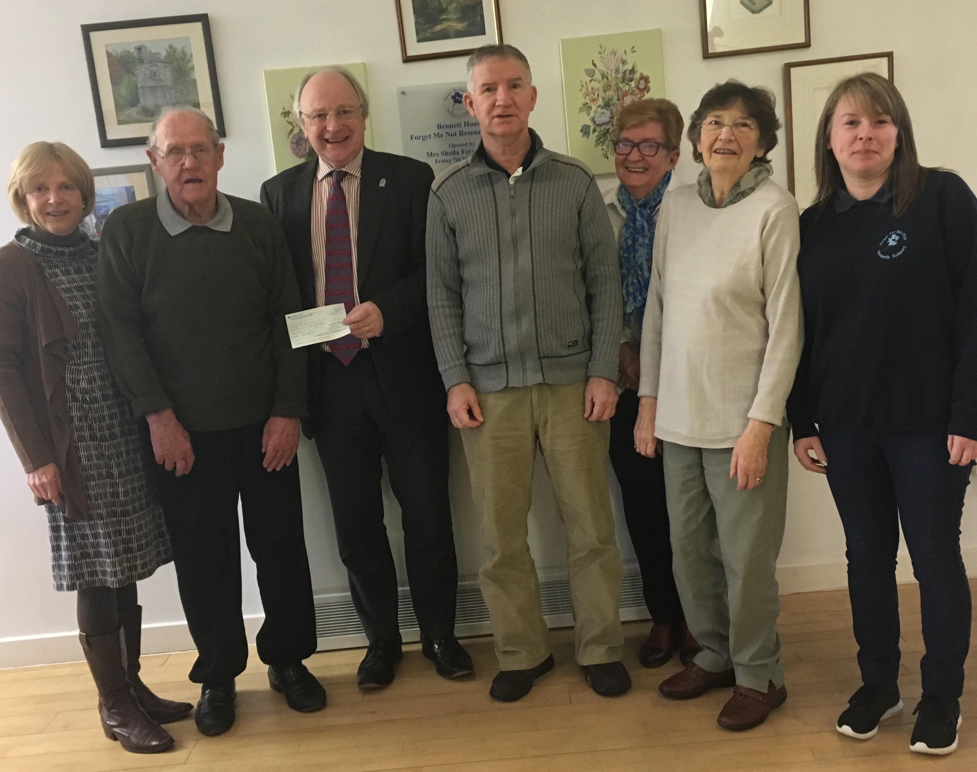 Malcolm Nicol presents a cheque to the Forget Me Not Club in Banchory.